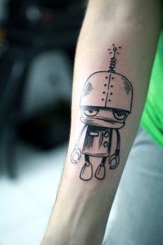 """I asked an illustrator friend of mine to draw a Paranoid Android (many references, the first is of course Hitchhikers guide to the galaxy, but also Radiohead [and the music paranoid android], and other personal things). This is the result, taken minutes after I tattooed it at """"Da Tribu Tattoo"""" in São Paulo, Brazil. Hope you like :-) Bruno"""