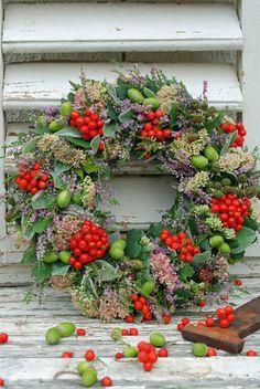 Stunning fresh berry and green acorn wreath