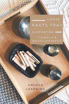 Supporting infant and toddler development and schema play through loose parts. Wooden pegs, metal bowls and a tray. Connecting, disconnecting, filling and dumping. Loose parts inspiring play with infants and toddlers by Lisa Daly and Miriam Beloglovsky Small World Play, Toddler Development, Metal Bowl, Outdoor School, Preschool Curriculum, Toddler Play, Wooden Pegs, Infants, Early Childhood