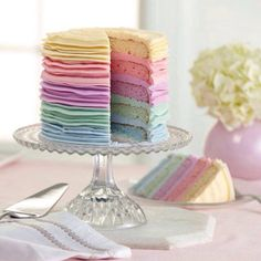 A rainbow cake is fun to look at and eat and a lot easier to make than you might think. Here's a step-by-step guide for how to make a rainbow birthday cake. Pretty Cakes, Cute Cakes, Beautiful Cakes, Amazing Cakes, Kreative Desserts, Petit Cake, Pastel Cakes, Pink Cakes, Gateaux Cake