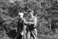 A Finnish Army medic (right)tends to a severely wounded Soviet POW (left), captured during hostilitiesof the Finnish-Soviet Continuation War. Near Simpele, Rautjärvi, Karelia (now, part of South Karelia), Finland. 1 August 1941.