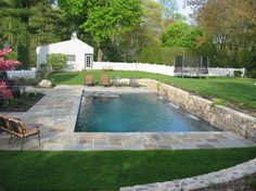 hubby would love the stone...but not the below ground part.... Above Ground Pool Surrounded By Deck Design Ideas, Pictures, Remodel, and Decor