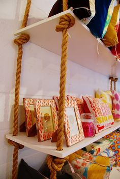 Creative DIY Bookshelves - Lots of great ideas & tutorials! Including this DIY rope shelf from honey & fitz.