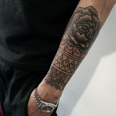 Black and white rose dotwork arm tattoo