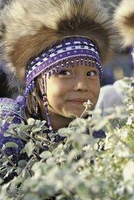 Yup'ik girl in traditional headdress at the Alaska Native Heritage Center in Anchorage, Alaska