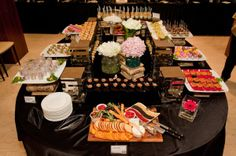 Buffet style food service with plates.