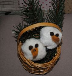 The only handmade Christmas decoration that's cuter than a snowman is a baby snowman. Make the Two Snow-Babies in a Basket decoration. You are sure to have guests crooning over the little snow-babies. Sew the tiny heads, set them in a mini basket with some greenery, and you have an adorable decoration that no one can compete with. Make extra little snowmen into ornaments or even fillers for glass vases. Be creative with this precious snowman craft.