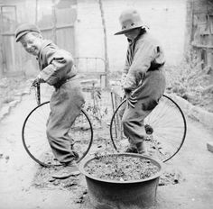 Nigel Henderson 'Photograph showing two unidentified children playing with bicycle wheels', [c 1949–c 1956] ©  Nigel Henderson Estate