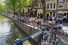 Cafe, canal, bridge, bikes, historic centre of Amsterdam, Holland, Netherlands, Europe