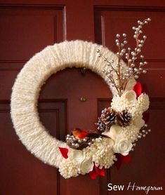 "Not only is this DIY wreath inexpensive and easy to make, but it is also stunning to look at and will really ""wow"" your guests this winter. Christmas Ornament Wreath, Christmas Mesh Wreaths, Burlap Christmas, Ribbon Wreaths, Yarn Wreaths, Winter Wreaths, Floral Wreaths, Burlap Wreaths, Spring Wreaths"