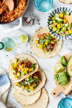 The BEST vegan tacos! These guys are filled with an aromatic, jerk-spiced vegan jackfruit taco meat and a sweet, juicy mango avocado salsa. Great for weeknight dinners, Taco Tuesday, or summer entertaining! | Love and Lemons #tacos #tacotuesday #veganrecipes #dinnerrecipes