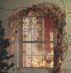 Rustic touch Christmas window decor with grapevine garland, lights and stars. Pic by texas Favourite & Country Treasures Noel Christmas, Primitive Christmas, Country Christmas, All Things Christmas, Winter Christmas, Christmas Fireplace, Christmas Lights, Primitive Decor, Rustic Decor