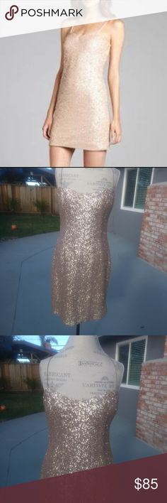 NWT- Kay Unger Mocha Sequined Mini Dress Mocha/Gold colored sequins spaghetti strap stretch mini dress. Fully Lined. Straps seem way too loose, will most likely needed to sew them into a custom fit. Zipper closure on back. No damage. Originally $488, selling at Nordstrom Rack for $180 on clearance!  Perfect for cocktails, wedding, prom, graduation...  Approx measurements: underarm to underarm, 19 in; across waist, 17.5 in; across hips, 21.5 in;underarm to hem, 27.5 in. Kay Unger Dresses Mini
