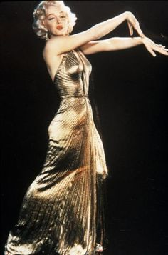 """❤ Marilyn Monroe ~*❥*~❤ in a pleated gold lamé gown made by William Travilla in """"Gentlemen Prefer Blondes"""" in 1953."""