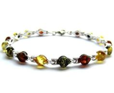 Sterling Silver Multicolor Amber Bracelet Length 7.5 Inches Graciana. $69.98. All amber jewelry designs are from Eastern Europe. Save 13% Off!