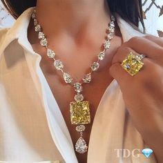 Moussaieff Jewelers, yellow and white diamond necklace and ring.