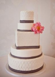 Simple cake add a few teal flowers and pearls draped off the table and its perfect