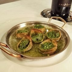"Escargot Maisons - snails baked in pastry ""shells"" with garlic butter at Le Crocodile #frenchfood #Vancouver"