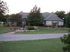 WOW. HUGE PRICE DROP. Truly Custom Home on 5 acres with many amenities. A must see! Two ponds. Large workshop. House set at back of lot for great privacy. Exquisite decorating with lots of wood and stone. Kitchen is a chefs dream. All rooms on first floor except media room. Rear covered patio runs the length of the house with 2nd story deck above. Too many upgrades and amenities to list here, see attached Amenities List.