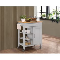 Features:  -Includes: (1) Shelf, (1) storage drawer.  -Solid wood and veneers construction.  -Locking casters.  Product Type: -Kitchen Cart.  Base Finish: -Gray.  Counter Finish: -Natural.  Base Mater