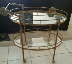 Mid Century Modern Italy Brass Bar Cart Vintage Bar Trolley Glass Shelves 1970s Hollywood Regency Barware by Panache1000Interiors on Etsy https://www.etsy.com/ca/listing/508762153/mid-century-modern-italy-brass-bar-cart
