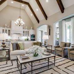From the beams, to the cathedral ceiling and subtle pop of color... this home is designed to perfection!