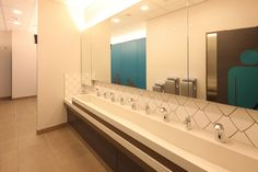 Three tone colour Corian trough vanity units installed by Washroom Washroom at the National Maritime Museum, 2011