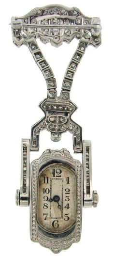 Art Deco Diamond & Platinum Lapel Watch with Glycine Movement | From a unique collection of vintage brooches at http://www.1stdibs.com/jewelry/brooches/brooches/