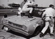 "Old school NASCAR... Richard Petty making some ""adjustments"" to his car during the 1968 Daytona 500."