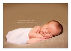 Tips on how to vary a tough newborn session.  Using a wrap and praying hands pose