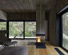 Uma casa minimalista sobre as areias #fachadasminimalistasconcreto