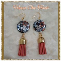 "Hippie Chic Twist Earrings Beautiful light weight earrings. Hippie style with a new twist. 3"" in length. Be your own beautiful. 14k plated with a suede feel tassel. The color of the tassel is tangerine. Offers are welcomed. Low balling with not be accepted. Thanks Tazze's Boutique Jewelry Earrings"