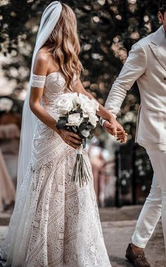 Top selling boho lace wedding dress with arm band. #weddingdresses #weddingdress #weddings #weddinginspiration #beachwedding #vintagewedding #laceweddingdresses