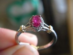 ruby set into a two-toned ring