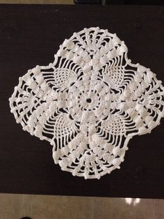 Check out this item in my Etsy shop https://www.etsy.com/listing/512830636/gorgeous-vintage-white-doily-four-sided
