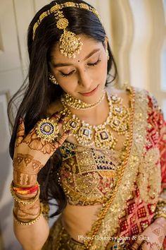 Phera, Bride, Gold multi-colored lehenga, Rimple and Harpreet Narula, Red, Bandini dupatta, Kundan jewelry, Bridal Photography, Bridal Portrait, Maang Tika, Kundan ring, Wedding Photography, Wedding Ceremony, Couple Portrait, Wedding Portrait, Outdoor shoot, Wedding Venue, Wedding ideas, Photography ideas, The Oberoi Rajvilas, Sam & Ekta, Sunita Shekhawat Jewelry Indian Bridal Outfits, Indian Bridal Fashion, Indian Fashion Dresses, Indian Designer Outfits, Designer Dresses, Rajasthani Bride, Rajasthani Lehenga, Bridal Lehenga Collection, Green Lehenga