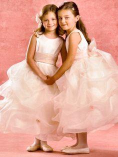 For Savanna and Emily (flower girls/junior bridesmaids) with a fuchsia belt.