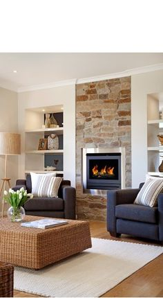 Inset fire within natural stone panel looks rustic but chic and adds just enough… Living Room With Fireplace, My Living Room, Home And Living, Living Spaces, Family Room Design, Fireplace Design, Navy Chairs, Lounge Chairs, Room Chairs