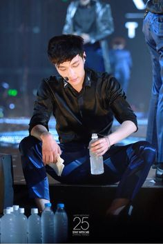 Yixing (Lay) The way he sit it's just so JFJSFBSBSKGLB
