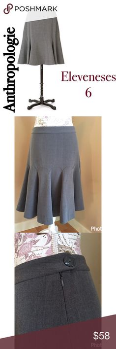Anthro Eleveneses heart lined trumpet skirt 6 Grey skirt with silky heart lining. Side half zip with button closure. Size 6 no flaws or signs of wear. Anthropologie Skirts