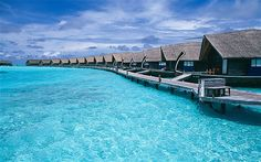 """Cocoa Island Resort, Maldives.  Joanna Page, actress  """"They have an amazing on-site restaurant, a tiny pool and a small stretch of sand for sunbathing. It's extremely private, which is what I loved most about it. Décor-wise, each hut is like a luxurious little mansion with beautiful wooden walls, a generous four-poster bed and glass floors, so you can see the fish swimming beneath your feet."""""""