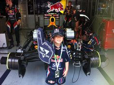 A tiny Red Bull Racing fan in Malaysia 2012 ---> In a word? Cute!
