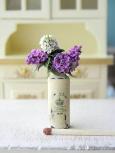 Dollhouse Miniature Bouquet, Miniature Lilac, Dollhouse Flowers, Flowers Miniature 1:12, Rustic, Provence, Country Decor, Vintage Style Lilac made from polymer clay. Each flower petal is handcrafted by me. Vase made from glass and is hand-colored by me with acrylic paints, artificially aged.  Each element is handmade. This item for: Lilac in vase.  Measurements: Height - 1,6 inch (4cm). Max diameter 1,02 inch (2,6 cm)   Material: polymer clay, acrylic paints, glass, vanish  This is a…