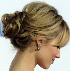Messy low bun with bangs. make it a side bun for the hair comb???