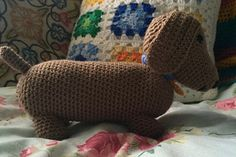 Amigirumi Dachshund worked in spiral fashion. Use a hook which gives a tight enough tension to give no gaps in the work. I used DK with a 3.5mm hook. I used approximately 75g acrylic DK in brown with scraps of blue, gold and black.