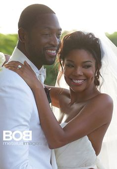 Gabrielle Union and Dwayne Wade at Their Wedding They are blessed to show the love they have for one another. :0)