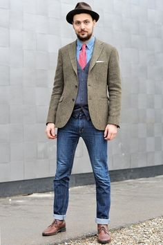 I have several pairs of cuffed blue jeans that I wear with a nice Pronto Uomo or Express MX1 dress shirt, a Pronto Uomo Blue V-Neck sweater, a complimentary tie with matching Hanes dress socks and Doc Marten Bostons with some hat.