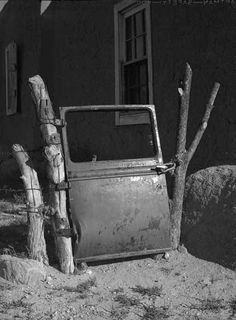 Car door gate, New Mexico, ca. 1930. Photo by John Candelario. Palace of the Governors Photo Archives 177238.