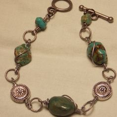 Check out this item in my Etsy shop https://www.etsy.com/listing/117812622/turquoise-silver-bracelet-gypsy-boho