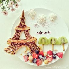 Lee Samantha's food-art - J'adore Paris.   With Love, Leesamantha - created June 2013 Instagram @Mi-Jeong Song Lee  Ingredients: 1. Eiffel Tower made of pancakes.  - Pancake batter in the squeeze bottle to draw the shape. - Nutella or Choc fudge for details.   2. Clouds - Whipped cream    3. Trees - Kiwi - Veggie sticks  4. Landscape - Fruits